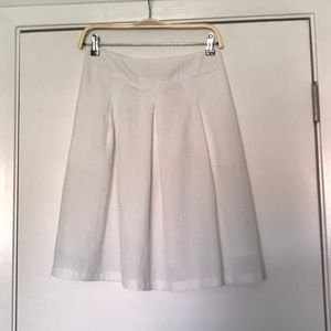 White knee length skirt